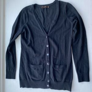 Black cardigan with pockets.